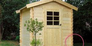 Een houten tuinhuisje plaatsen