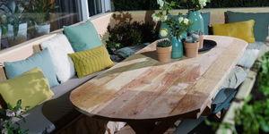 Maak een ovale eettafel voor in de tuin