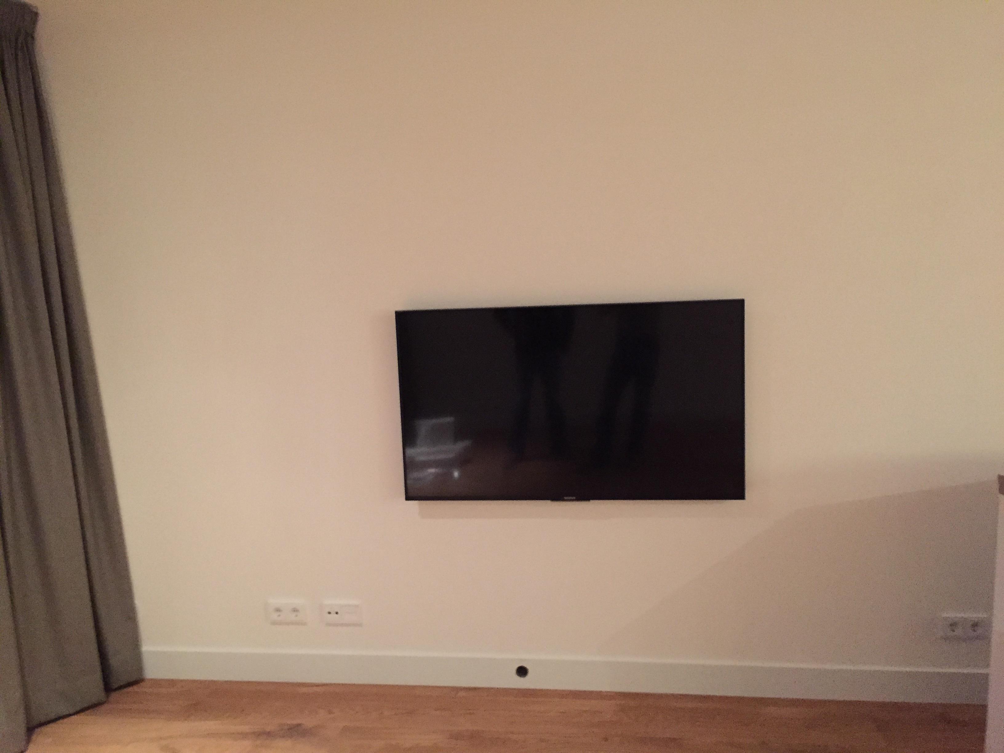 Tv In Muur : Tv ophang beugel voordemakers